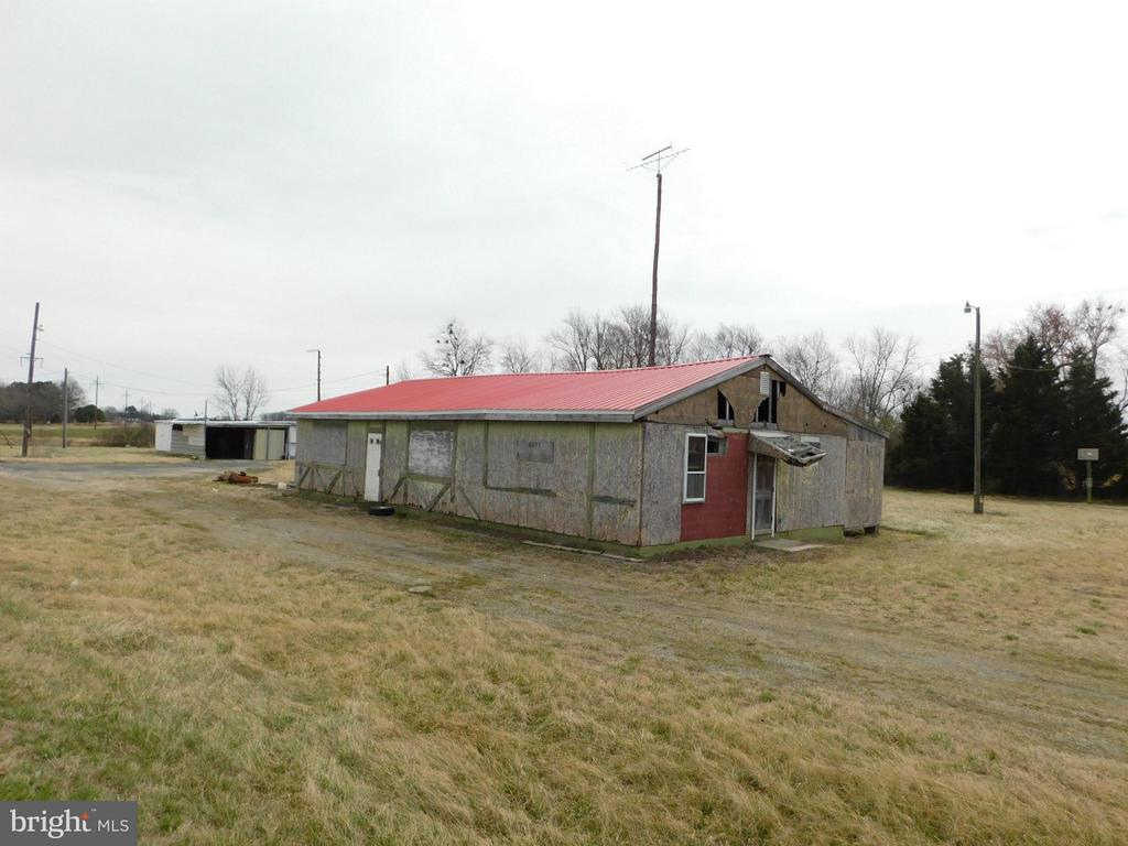 Large commercial property on busy U.S. Rt. 50. Old mobile home and old building - both need work. Price also includes 4079 Ocean Gateway (where mobile home is).