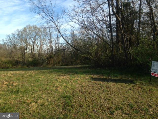 Rare lot offering on Meadow Ridge Drive at Cress Creek Country Club. Backs to golf course. Almost an acre! Partially wooded with water and sewer hookup. Absolutely wonderful building site in an established neighborhood.
