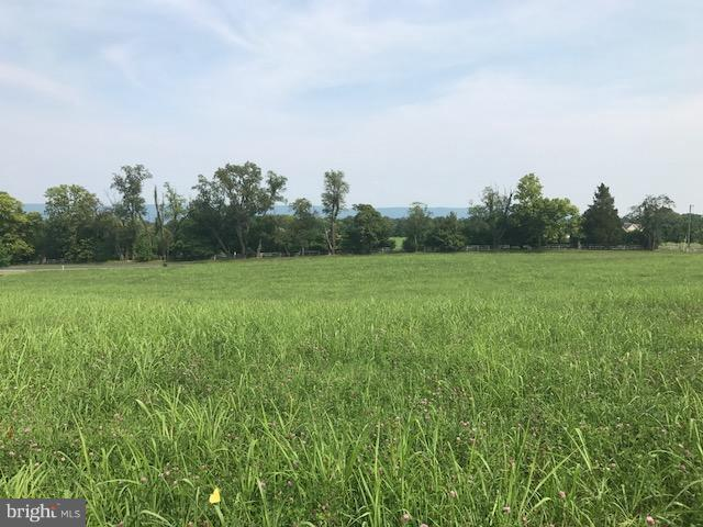 Beautiful almost 10 acre lot in a small community only 7 minutes from Shepherdstown. Easy access to commuter routes. Building site would be high with a mountain view. All cleared, perked,  and ready to go!