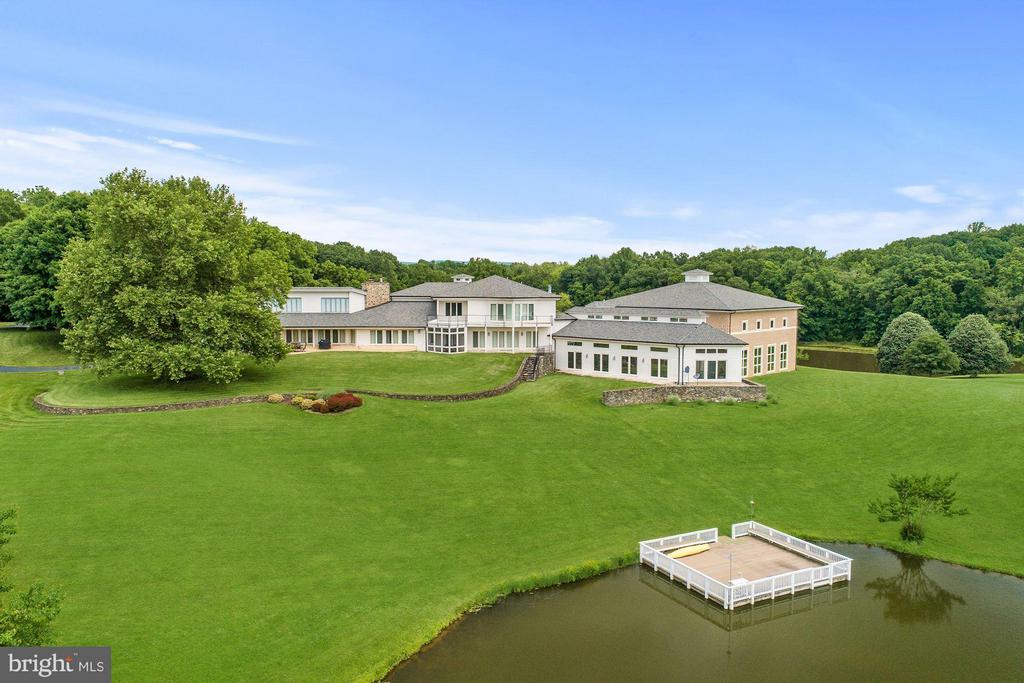 This beautiful estate boasts approx 116 acres consisting of 10 lots, incl 2 pristine lakes w/dock - perfect for fishing & boating. Renovated in 2004, the 5 bed/10 bath 22,000+ sq foot home is an entertainer's dream w/ indoor pool & hot tub, bowling alley, home theater & basketball court. The natural light-filled home allows scenic views from every angle. Seller not responsible for roll-back taxes.
