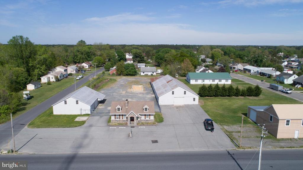 Reasonably priced commercial property.  Remodeled office space - could be split into two units. Outside fenced yard/parking. Two large warehouses. Owner may consider lease/purchase