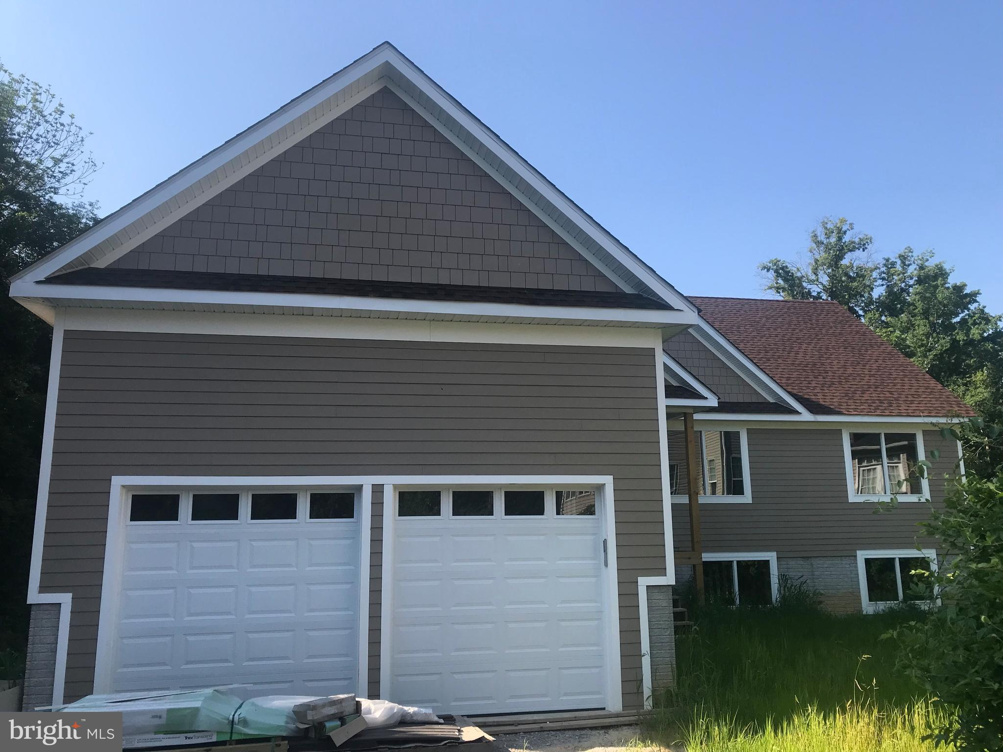 NEW HOME, OVER 3700 SF IN SECLUDED WOODED AREA BACK UPS TO COUNTY PARK LAND. CONSTRUCTION ALMOST COMPLETED. BUY NOW AND SELECT FINAL FEATURES. OPEN-STYLE DESGN WITH SPACIOUS DECK AND PATIO