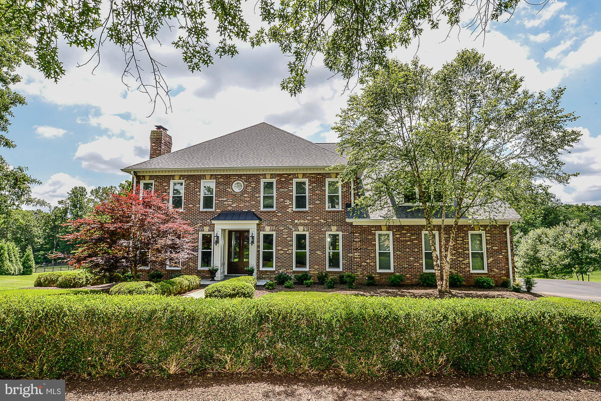 STUNNING top-to-bottom renovation (over $900k in past 2 years), 5 BR home on 5 acres. Open floor plan, gleaming hardwoods, all new light fixtures. Kitchen features paneled Thermador and Bosch appliances, custom cabinetry, quartz countertops. MBR w/ enormous walk-in his/hers closet and spa-like bath. FABULOUS outdoor space (see pics for details). New roof, windows, doors - no detail overlooked.