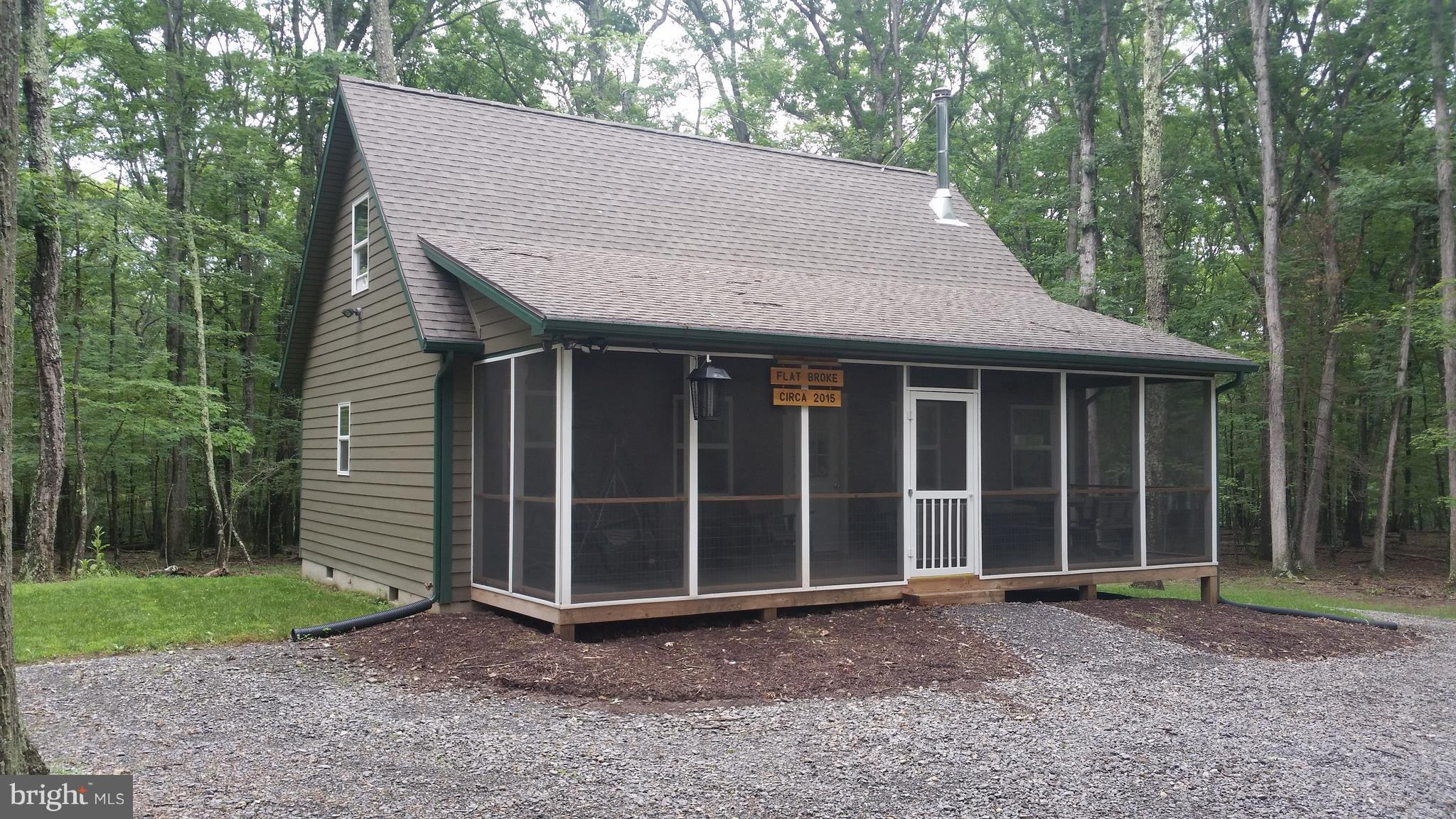 As-New,100% Maintenance Free Chalet with Cacapon River Access, Built in 2015, used very lightly, you'll be impressed with the condition and layout of this weekend get away. Great Room design with wood stove, 1 bedroom and loft, 1.5 baths and will comfortably sleep 6. Nicely Furnished, Beautifully wooded private lot just up the mountain from the community river lot. Ready to enjoy NOW, call Today!
