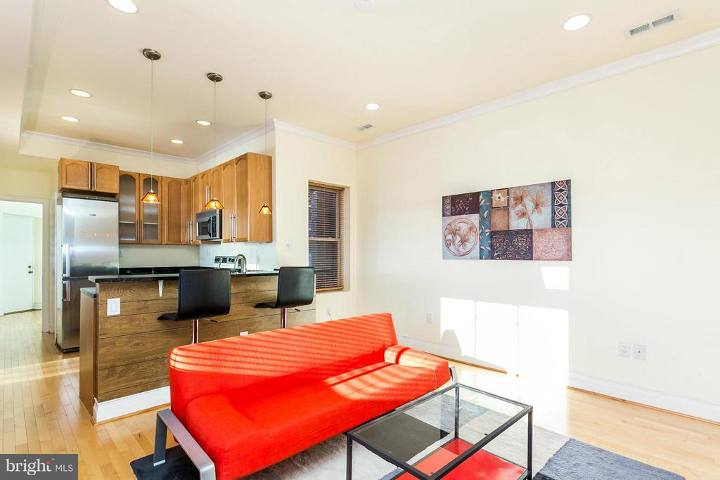 Fully renovated multi-unit with three modern 2BR, 2BA apts. Move into one and rent out the other two or rent out all three. Sleek appliances and hardwood throughout, walk-in closets, hot tub spas, high ceilings, exposed brick, skyline views, and rear parking.  Near Penn north, subway, Light Rail, UMD and Hopkins