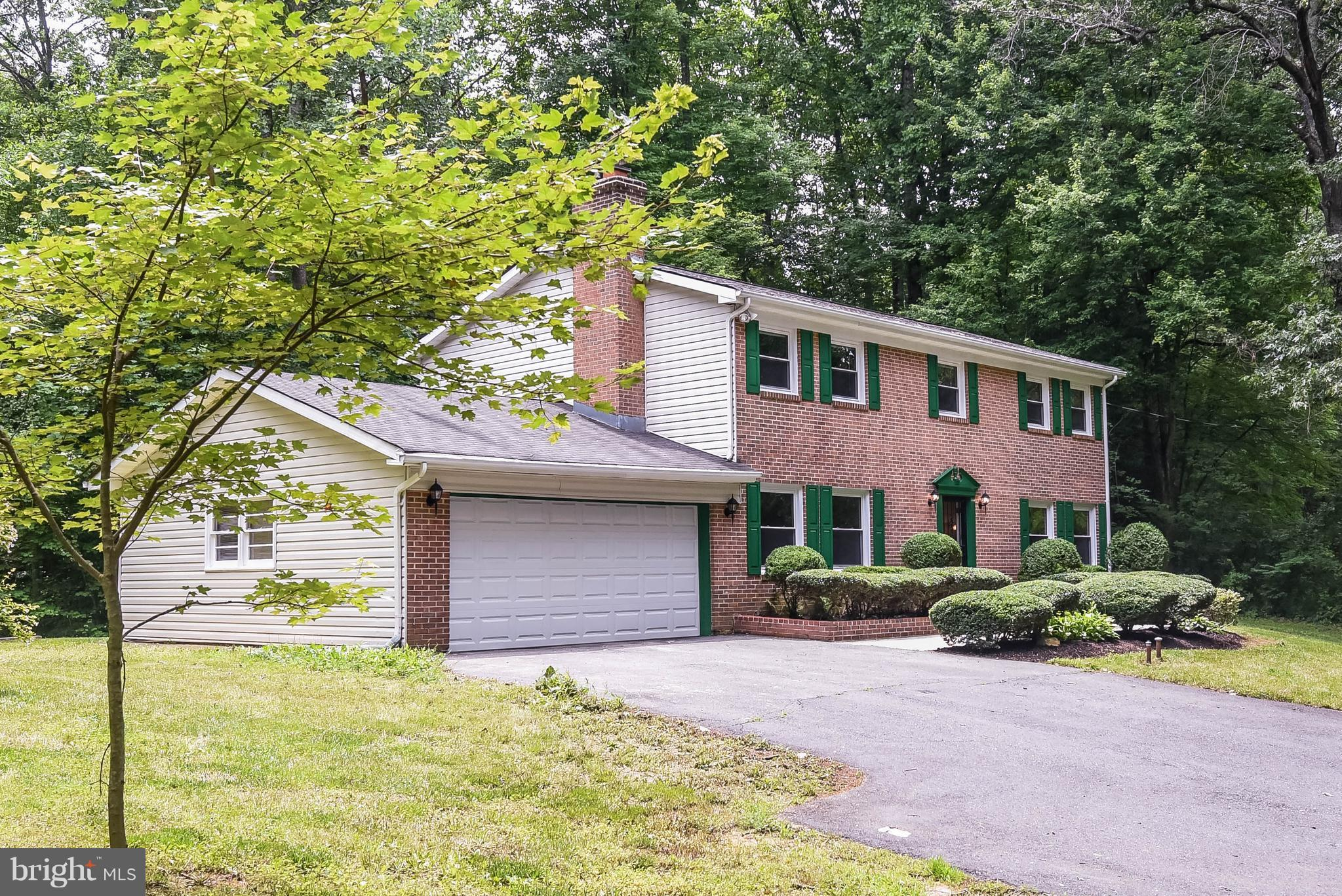 Living is easy in this impressive, generously spacious residence in Oak Hill. Perfectly situated at the end of a quiet road this home offers 4 bedrooms, 2.5 baths and all in 2200 sq ft of living space on a .7 acre lot.  Move right in.  No need to paint, this home has new paint and new carpet throughout. No homes in the area can compete with this brick front colonial. Get out to see it right away!