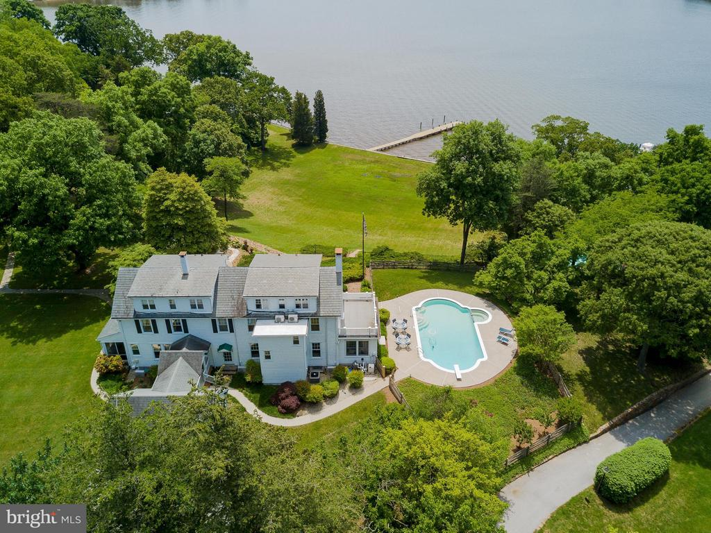 NOW OFFERED BELOW APPRAISED VALUE, the Parker Estate commands one of the most expansive views of the Severn River. This exceptional 8 acre property is a private oasis in the middle of Severna Park. Home and pool sit on a terraced bluff, 200 ft of waterfront, deep water pier. Ceilings on the first floor are 9 feet! The estate is perfect for everyday living / exceptional entertaining! Floor plans in docs., video in virtual tours. It has conditional county approval to be subdivided into 2/ 4 acre waterfront parcels. For more information visit TheParkerEstate.com
