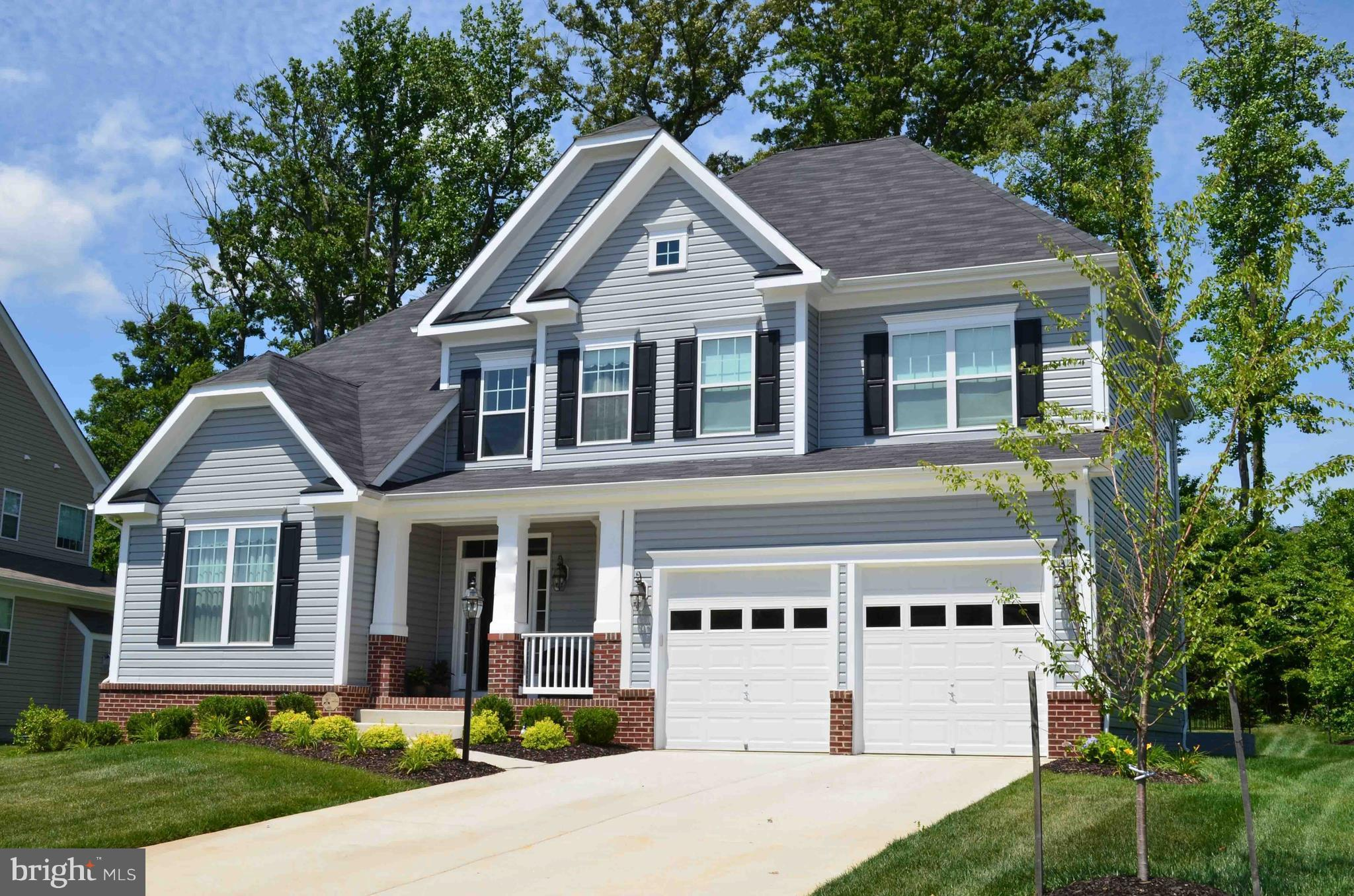 """To-Be-Built!!  Our popular Bedford Model. Kitchens with 42"""" Cabinets Granite & SS. Gas Fireplace. HW Floors in Foyer, Main Stairs, & Kitchen. 4 Piece Crown Molding & Chair Rail. Ceramic tile in all Baths. Concrete Driveway, Sodded Yard, Landscaping, Cast Iron Mailbox & So much more in options!"""