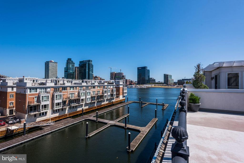 Come discover this fantastic four bedroom direct waterfront Pier Home located on Baltimore's famous Inner Harbor. This architectural wonder is located directly on a pier behind the private gates at Ponte Villas South offering unmatched privacy and security. Spectacular views are featured from all five spacious levels within this 3,732 square foot dream home. Luxury features include a five level elevator, three overwater balconies, gourmet kitchen with gas cooking & granite counters, gas fireplace, hardwood flooring and extra large rooftop terrace. Parking for two vehicles is provided for within the attached two car garage.  Community amenities include 24/7 security, a private guest parking garage, outdoor pool, private fitness center, concierge services, multiple restaurants, marina, dock bar and beautifully landscaped grounds.  A conveniently located water taxi can take you to explore any neighborhood in the city.  With countless shopping, dining and entertaining options just minutes away from this centrally located Inner Harbor property you can enjoy a lifestyle offered nowhere else in Baltimore.