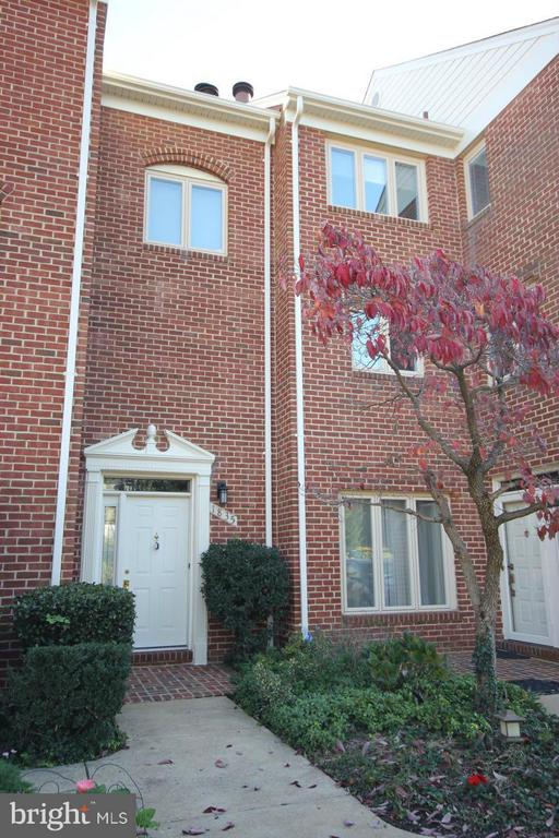 A PROFESSIONALLY MANAGED PROPERTY. Two master suite two-level townhome featuring main level hardwoods, living room fireplace, balcony, private patio, reserved parking and more. Close to Metro, DC, schools, shopping, entertainment and major access routes.