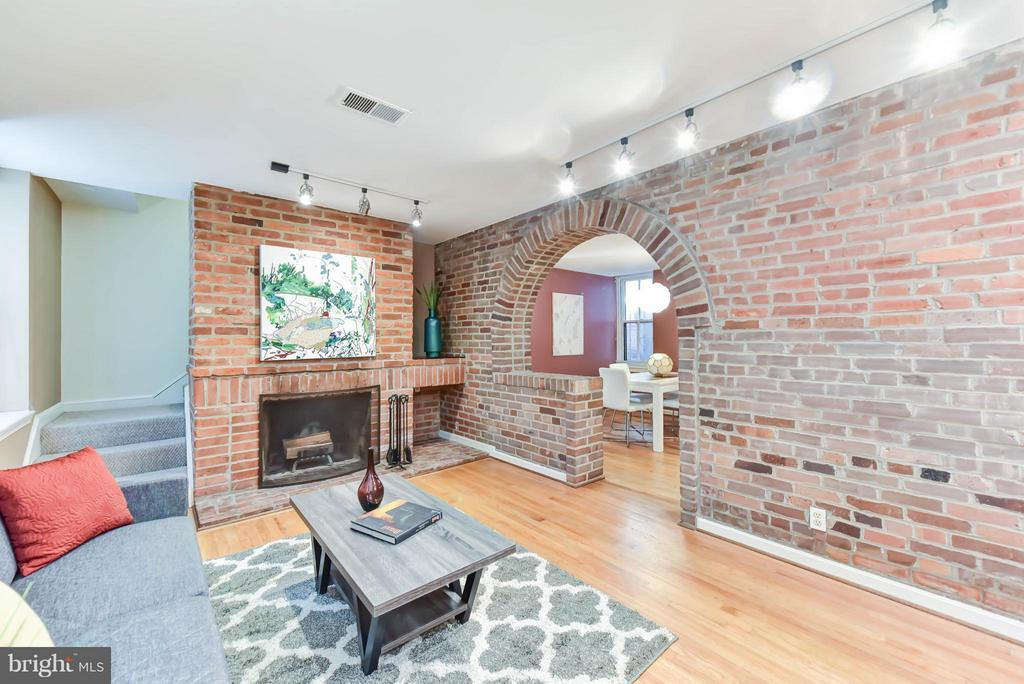 PRICE REDUCED! Fabulous value on The Hill - This 3BR/2BA 2-level condo boasts hdwd flrs, fireplace & exposed brick, separate DR, pass through kitchen & true master suite w/ separate sitting area. AND private patio w/ alley access~grilling permitted! Extra storage & Walkscore: 91-Walker's Paradise! Only 5 minutes to I-395/695  and I-295. Dog friendly &  no rental restrictions. OPEN SUN 6/17 2-4pm.