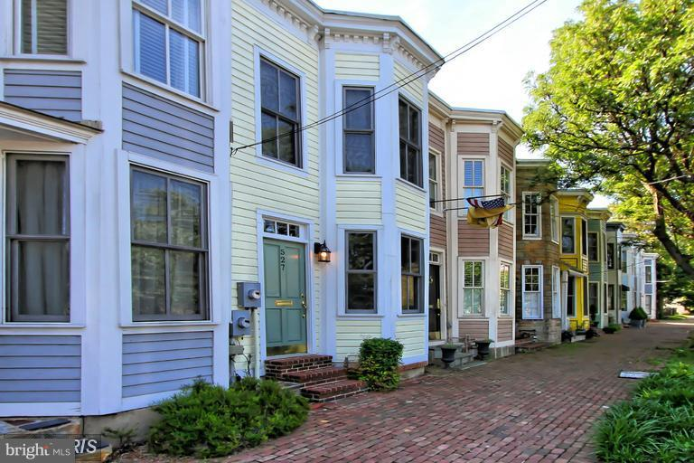 Totally renovated  Arts and Craft TH in Old Town-short distance to Metro. There are bay windows in Master Bedroom and Oak Floors. Gas log in Stone FP-Lovely Kitchen and MBR Bath/ French doors off kitchen open to a private garden.Is a chaming TH with many updates and upgrades. This one has great full bath and half bath.