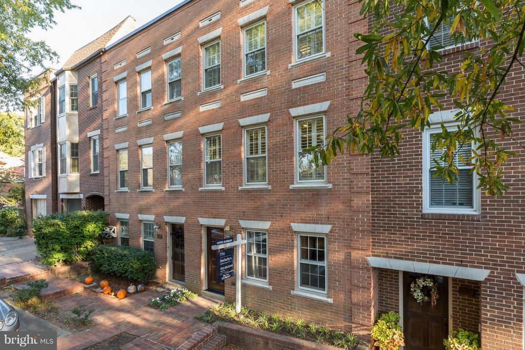 Gorgeous townhome just minutes from Georgetown/DC, along commuter routes, in a quiet setting. Feature 3 bedrooms and 3 full baths, hardwoods, stainless appliances, granite countertops. Relax on the private patio or on the balcony. Main level includes den with wet bar. Reserved parking spot plus plenty of on-street parking too. Close to shopping/Rosslyn/Metro.