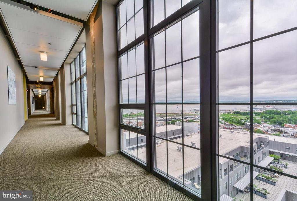 """Amazing sunrise, city & water views from this incredible 2 bed 2.5 bath with TWO interior convenient parking spots.  City living at its finest in this """"former grain elevator"""" award-winning adaptive re-use project.  Plenty of amenities: 12+' ceilings, floor-2-ceiling windows, high end kitchen appliances & granite, under cabinet lights, wide plank wood floors, private exterior balcony, master suite w/spa like bath. . Condo feats 24 hour front desk, fitness center, 19th-flr Sky Lounge. Storage Available."""