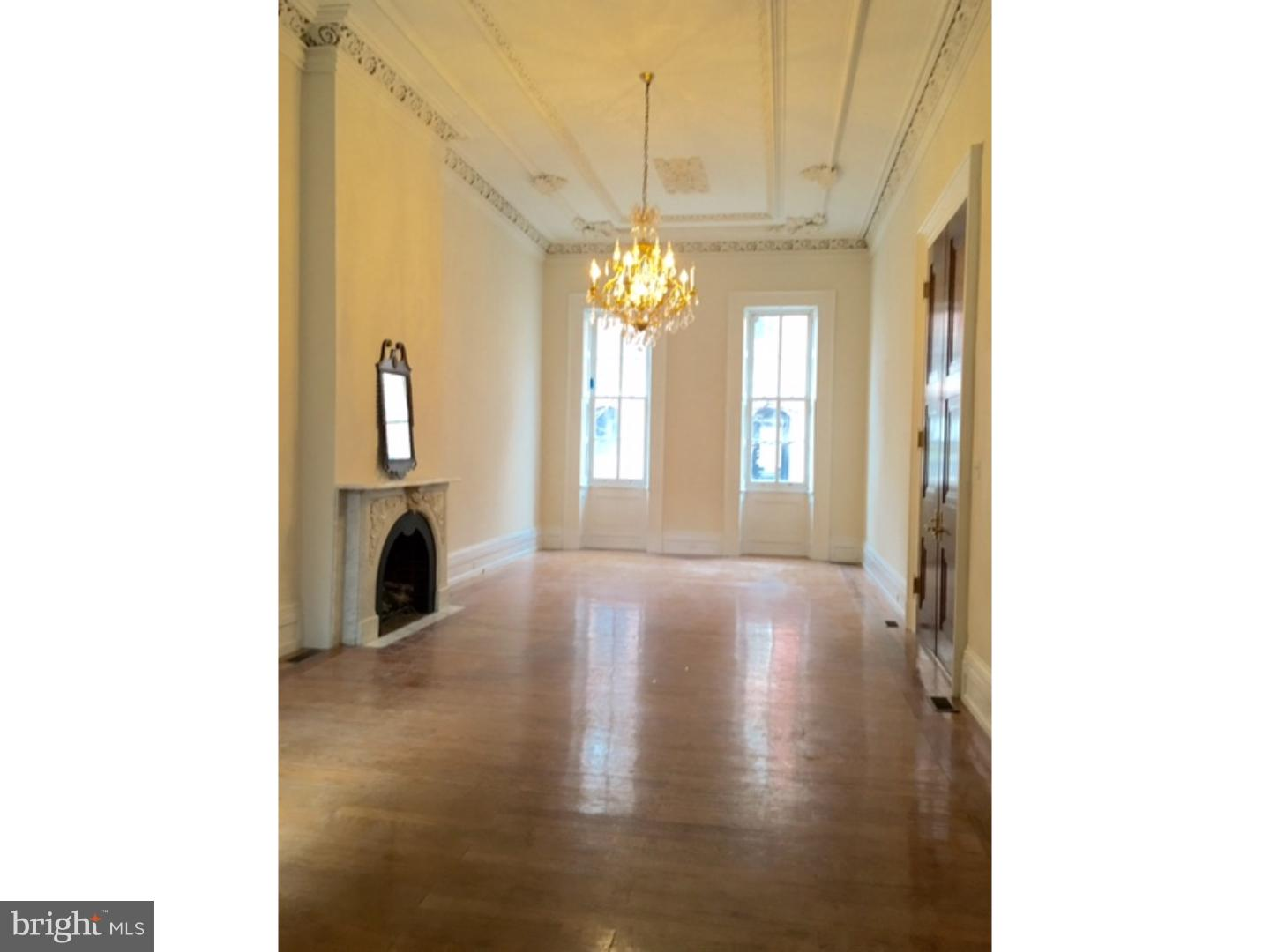 Are you looking to get to Jefferson, or Pennsylvania Hospital or CHOP in 10 minutes or LESS? This ENORMOUS 2/3 bedroom 3000+ sq ft residence is a MUST SEE!! In this AMAZING BROWNSTONE!! As you enter through french DOUBLE DOORS, you will find, 15 ft ceilings in the living room, heated floors in the just renovated eat in kitchen and full bath, side garden, and 1st bedroom w/ a large closet. An elegant set of stairs leads you your second living space/ den and Master suite w/ marble bath and ENORMOUS. Private roof deck!!! The lower level of this apartment, also has heated floors,  and a full bath as well! 2 car parking available