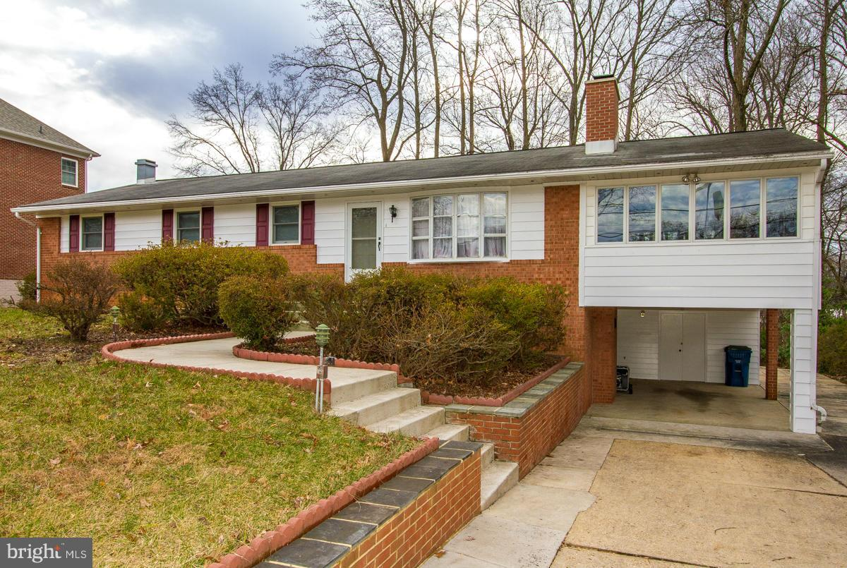 Beautifully renovated brick home on nearly half an acre! 5 BR, 3 Full BA, freshly refinished hardwood floors throughout main level, SS appliances, and a HUGE sunroom that sits atop large carport. Just blocks from Gallows Rd & 495.