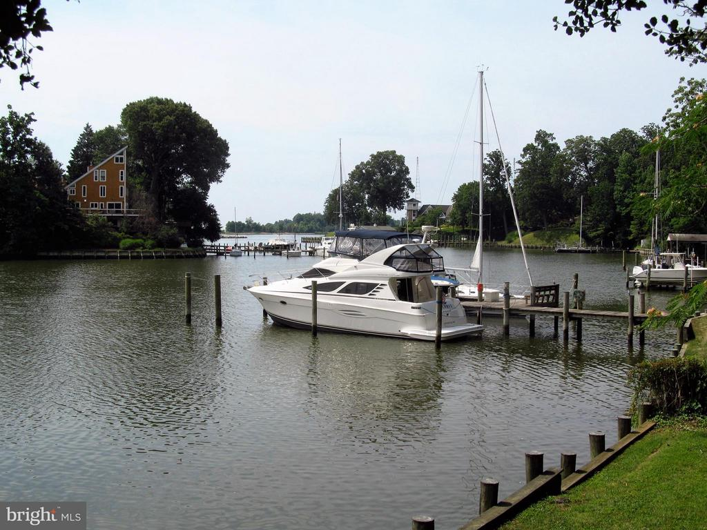 St. Margaret's waterfront property on desirable Hidden Pt. Rd. with Chesapeake Bay view. Rare boater's opportunity to be minutes from the Bay on a protected deep water creek. Renovate or build your dream home on this one-acre lot. The value is in the lot and it's potential.  Property has 100K of work completed including a new dock, sea wall and a septic system for a home over 3,500 sq./ft.  by current owner. CURRENT OWNER HAS FULL SET OF APPROVED PLANS FROM AA COUNTY THAT HAVE NOW EXPIRED. These will be extremely helpful for the next owner.