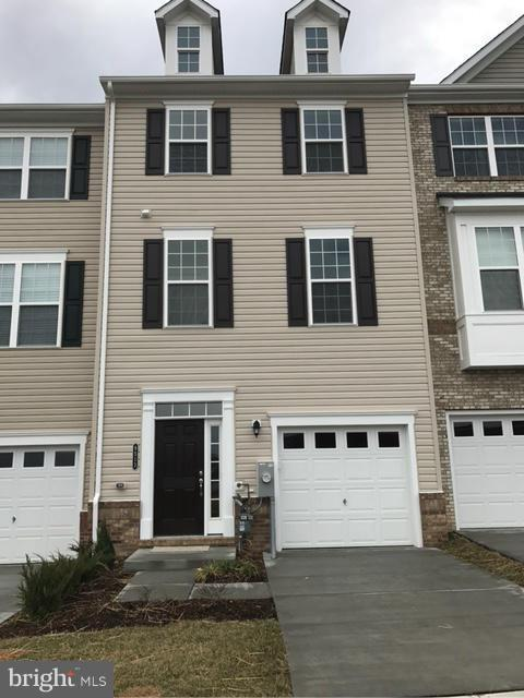 Gorgeous end unit town house in Owings Mills newest community Ballard Green. Open floor plan, large gourmet kitchen, full size deck, and spacious master bedroom with master bathroom suite including soaking tub and separate shower. Lower level bedroom and full bath with walk in level access. Close to major commuter routes.  Community Pool is included.