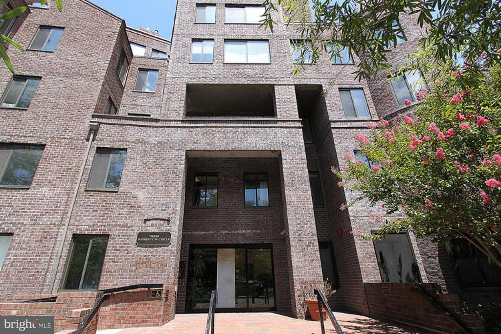 This 1BR 1.5 Bath condo feels like a house with it's own separate entrance. Great Light (south exposure ) with view of Washington Circle, caddy corner to Ritz Carlton and George Washington University, 3 blocks to Metro, Wood floors, Updated kitchen, W/D in unit.1-car garage parking included.  Walk to both Whole Food and Trader Joe's. PRIME LOCATION