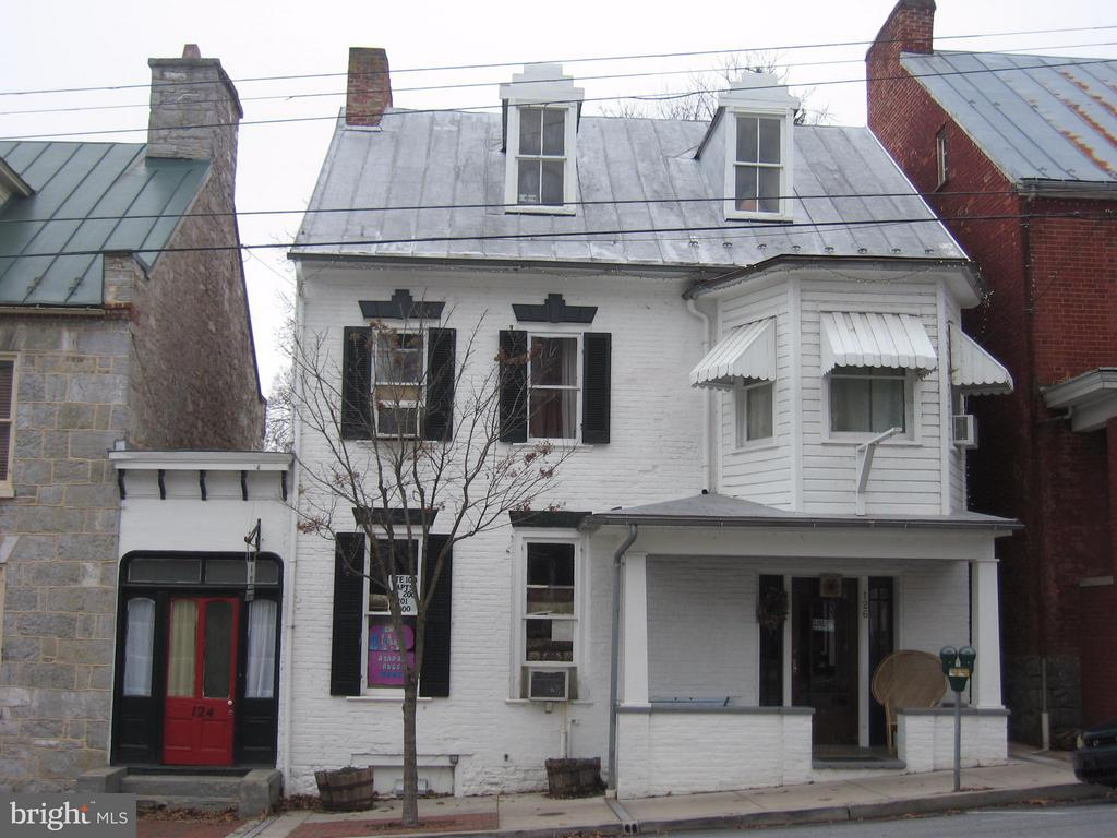 Two commercial spaces on main level and four apartment rentals in this downtown Shepherdstown main street building. Many original period features intact including original staircase, fireplace mantels. Large rear yard with four parking spaces off the rear alley. Covered front porch at 126 with knee walls for privacy. Finished sq. footage 3,674.
