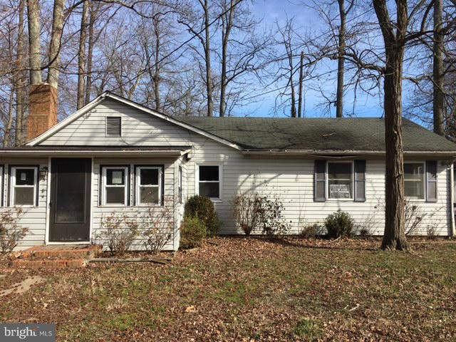 Rambler located in quaint Beach Community. Best opportunity in town to either rehab the existing home, or  build your new dream beach house on a nice wide level lot. Features include a cozy fireplace in the family room, eat-in Kitchen with bay window in the dining nook, plus den. Sold AS-IS.