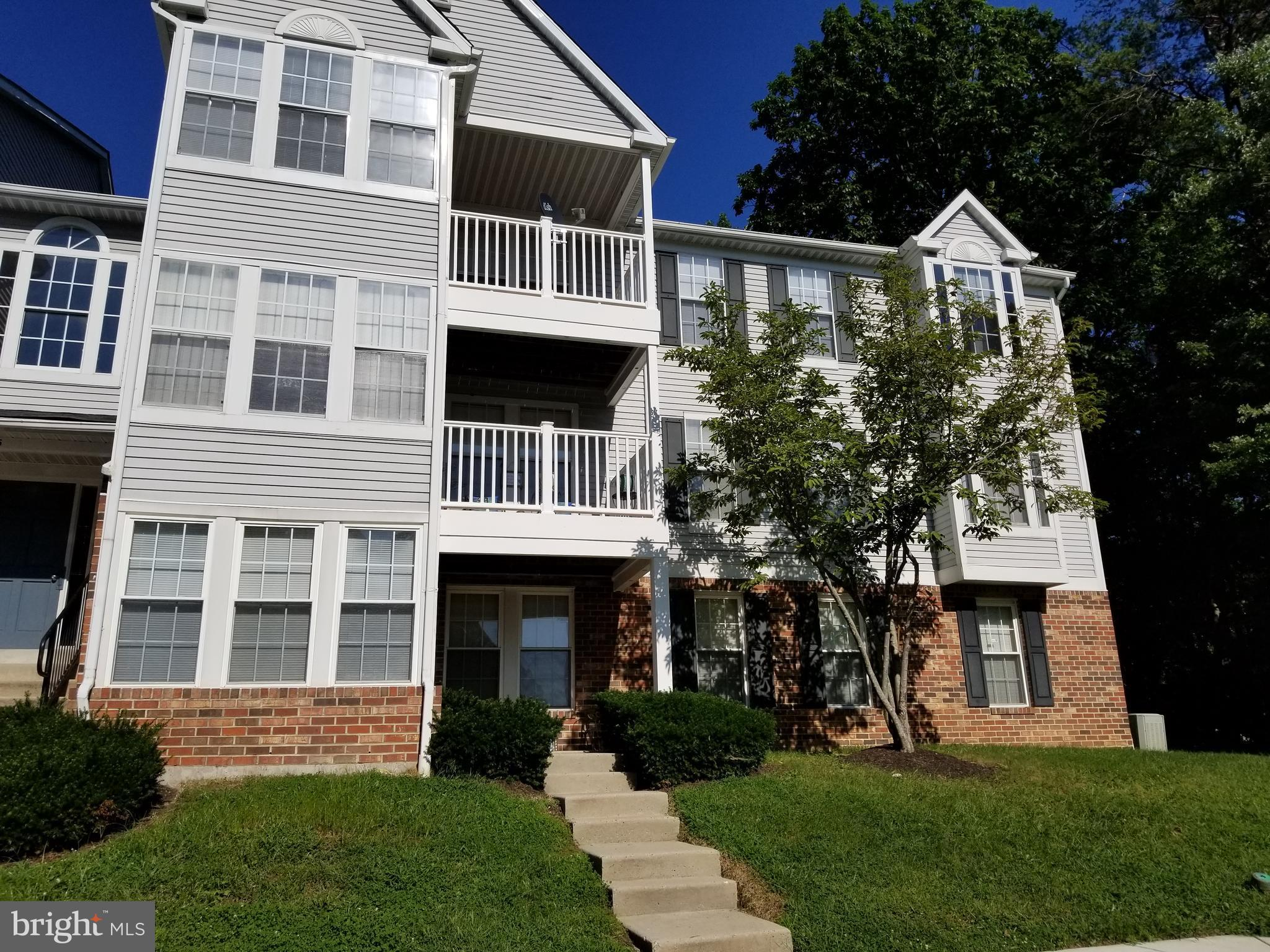 1st floor unit features new paint and carpets. Breakfast bar to kitchen, extra closet storage space in master bedroom, sun/bonus room, laundry washer & dryer, refrigerator, range, and mounted microwave. Association amenities include clubhouse, swimming pool, tennis courts, and playground.