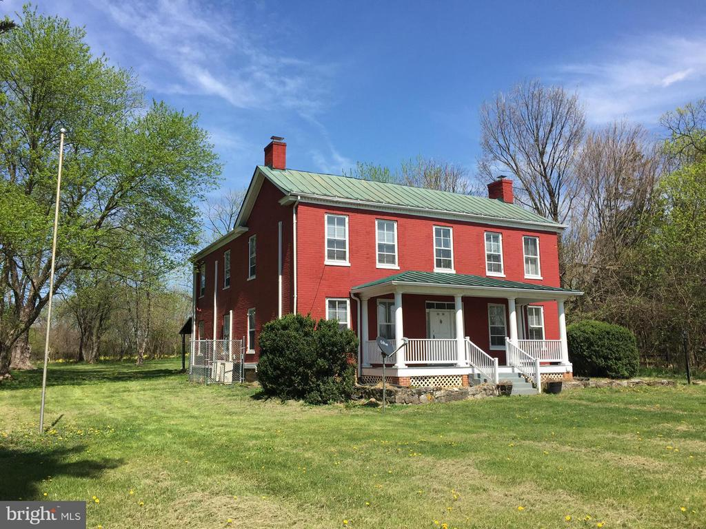 Historic Farm house many classic features.  Approx 1 acre of land surrounded by farmland.  Hardwood floors, new wood burning pellet stove, tall ceilings, 2nd story porch, new washer/dryer/fridge.  Pets considered on a case by case basis.  Strong credit worthy candidates preferred.