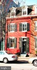 Charming historic 2/3 bedroom townhouse only 4 blocks from King St metro. Large formal living room, separate dining room, both with fireplaces (decorative only), brick floor in large eat in kitchen, walk out to private brick patio, carport provides 1 off street parking spot, High ceilings, period details. Pets on case by case with deposit. *Note, third bedroom on third floor is accessed by walking through second bedroom. Second bedroom perfect for nursery, office or tv room.