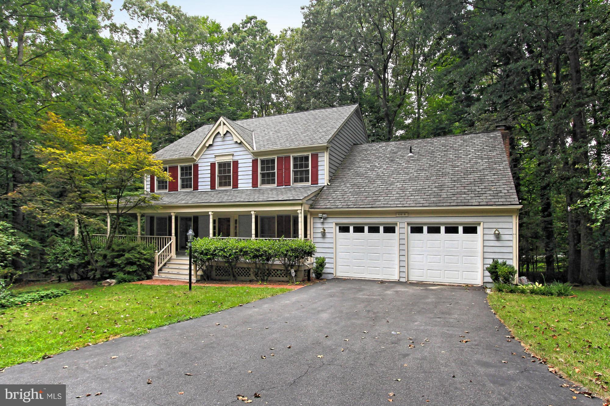 Elegant Colonial home w/5 BR & distinctive wraparound porch*Private/peaceful/idyllic.84 acre setting surrounded by trees*Pvt den on ML w/adj full bath*Refinished hardwoods in LR/DR/entry*Remodeled gourmet kit w/bkfst area/bay window*Great FR off kit w/cath ceilings*Big MBR suite w/lux remodeled pvt bath*Daylight LL w/5th BR/4th full bath/2nd kitchen area*Large deck*Sprinkler system*