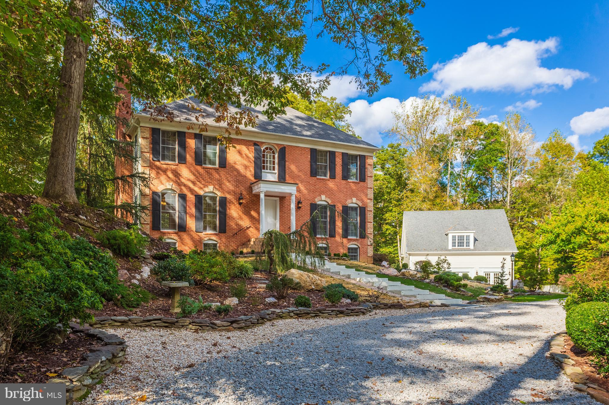 Custom Williamsburg Colonial w/seasonal wooded/water views, attached Garage & Detached Guest House! Open floor plan w/loads of light! Gorgeous hdwd flrs, 3-FPs (MBR,FR,LL), Granite Kitchen & FBAs, custom moldings, Finished W/O LL! Guest House w/GreatRm, 2FBAs, Kitchenette,BR5 & Laundry, hdwd flrs, hi ceilings! Deck & Shed! Main House (3264SF) & FULLY PERMITTED Guest House (1876SF)!