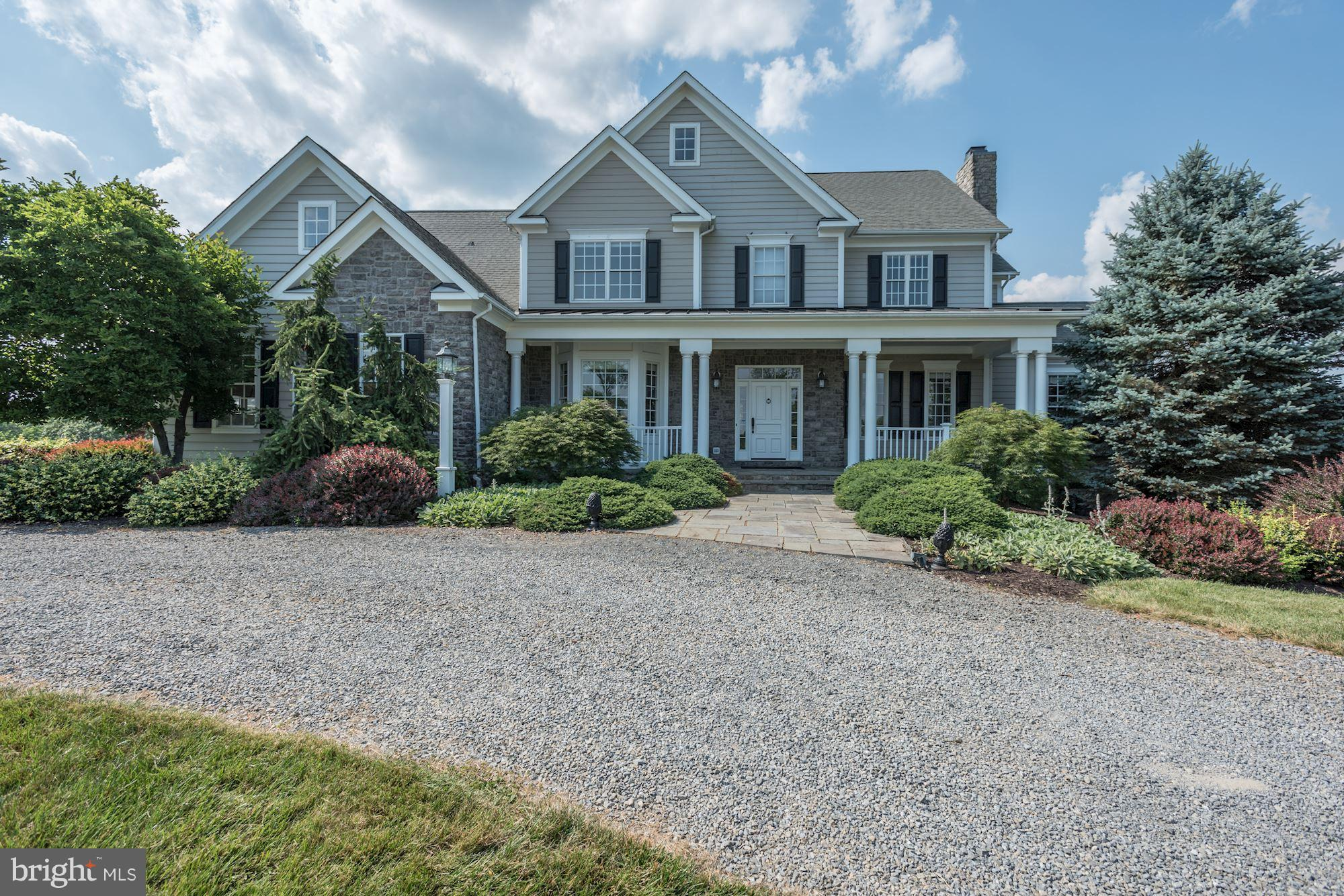 Retreat from the city to this gorgeous 5 BR/4.5 BA farmhouse on 10 acres of countryside in Waterford w stunning views! Family living at its finest w 5500+ sf of living space w/ an open floor plan, light-filled rooms, 3 fp's, built-ins, and wonderful light.  Large, open chef's kitchen, master BR retreat, oversized 3 car garage, updated systems, covered front porch + rear deck