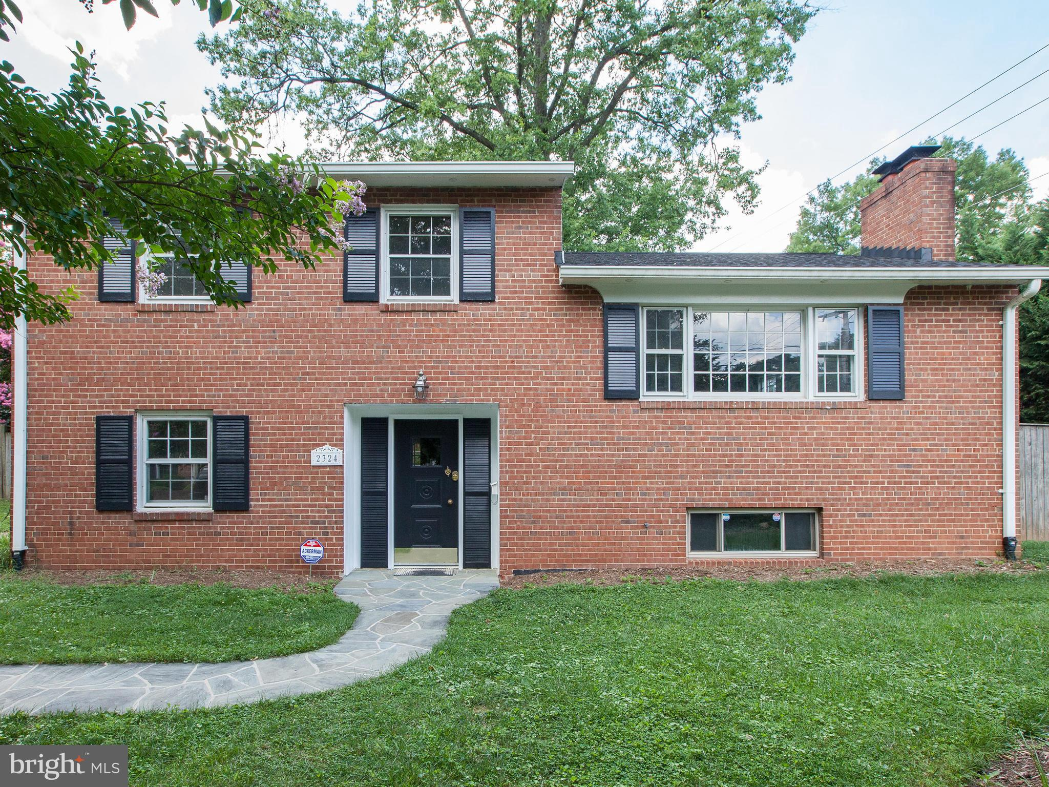 4 BR/2.5 BA brick home on a corner lot in N Arlington w/ fresh paint + refinished floors! Sunny LR w WB FP followed by a formal DR that overlooks a large, fenced back yard. Kitchen features new granite counters +gorgeous cherry cabinets & opens to a rear patio perfect for entertaining. 2 BRs up + 2 more down+ rec room w wb FP! 6 blocks to E. Falls Church Metro + I-66! Yorktown HS pyramid.