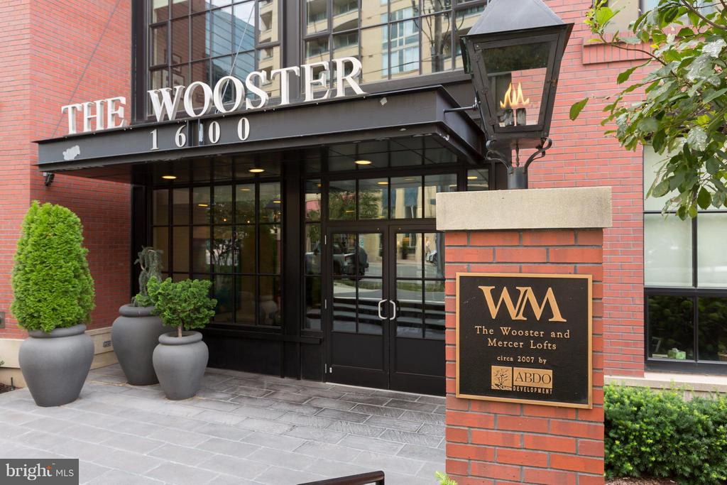 NY Style Loft Residence in the sought-after Wooster & Mercer Lofts in Rosslyn. This top of the line residence has the best of everything, with a gourmet kit, top of the line appliances, two spacious bedrooms and spa bathrooms. This residence is located in a full amenity building that features a concierge, gym, pool, & club room You are minutes to Metro, Grocery Store, shops and restaurants.
