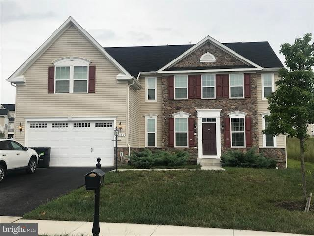 Motivated Seller, 3262 sqft in this stunning upgraded 5 BR, 3.5 BA home in Cardinal Grove! Hardwood on main level, upgraded granite, tile & soft close cabinetry throughout. Beautiful gourmet kitchen open to living space and eat-in area, butler's pantry. Lower level has a bar, theatre for entertaining, walk out family room, 11 ft ceilings and large storage area. 2-car garage and security system.