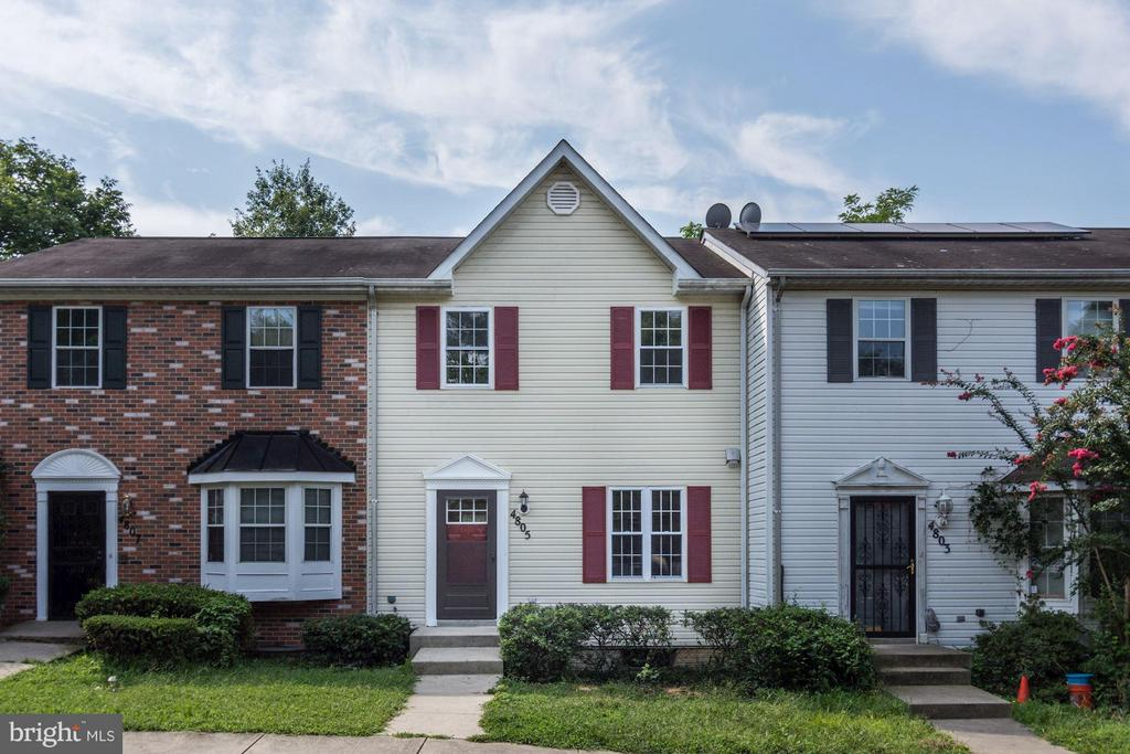 Beautifully renovated townhouse with new shaker kitchen cabinets, granite counters and stainless steel appliances.  This home offers updated tile and fixtures in each bathroom, including the main level half-bath, new windows and HVAC.