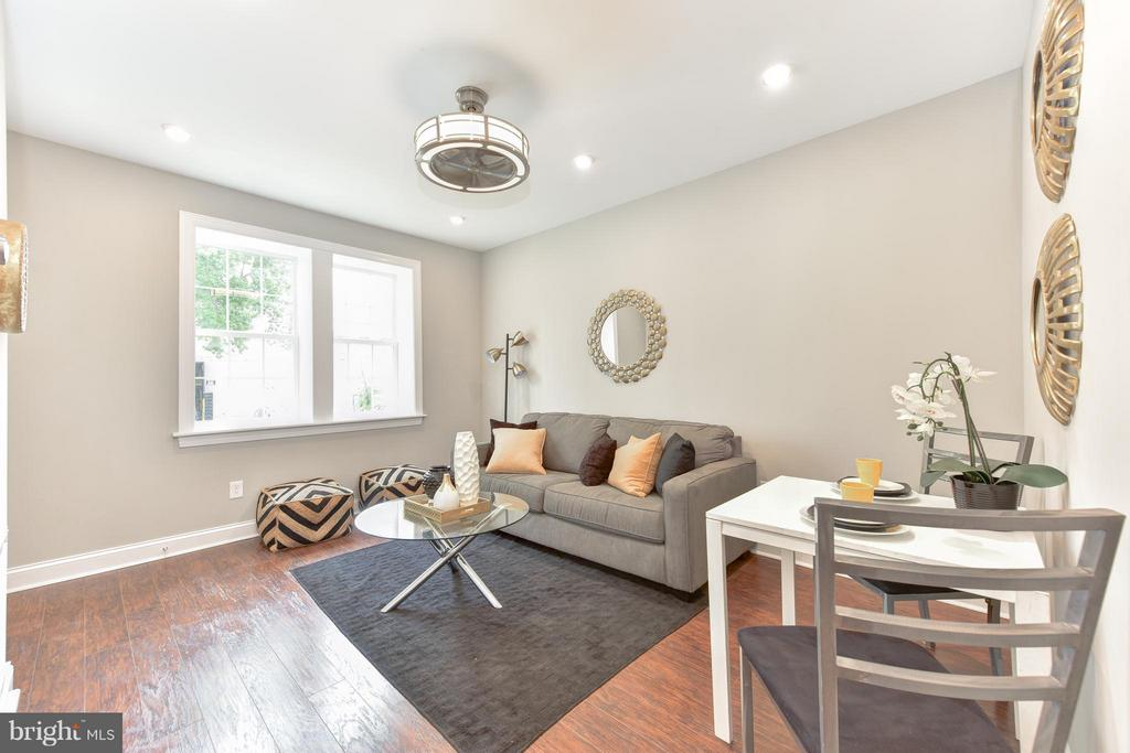 5K CLOSING COST CREDIT - BEST value in Brookland, this boutique condo bldg has 4 newly converted/reno 1 BR+lrg DEN units. Tons of natural light, hickory-stained flrs, recessed LED lghtng, SS appl, granite counters, modern style fixtures, W/D in unit, NEST thermostat & video intercom system. ENJOY front yard/garden, back decks & PARKING. Close to Redline Metro, 12th~St shops/ restaurants.