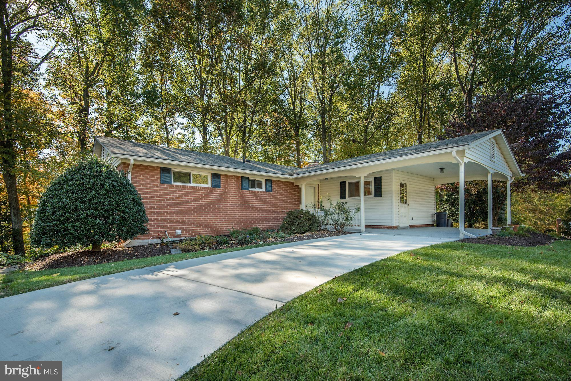 3 BR/3 BA rambler on quiet cul-de-sac in Kings Park West! Formal LR w FP, DR+sunny kitchen w bfast room. Master suite, 2 BRs +hall BA. LL full BA+large fam room w new carpet+gas FP. Steps out to lovely stone patio&private yard. Large Laundry+storage rm. HW floors, updated roof and windows, covered front porch+attached carport! Easy access to Braddock Rd, Laurel Ridge ES + GMU campus! OPEN SUN 2-4!