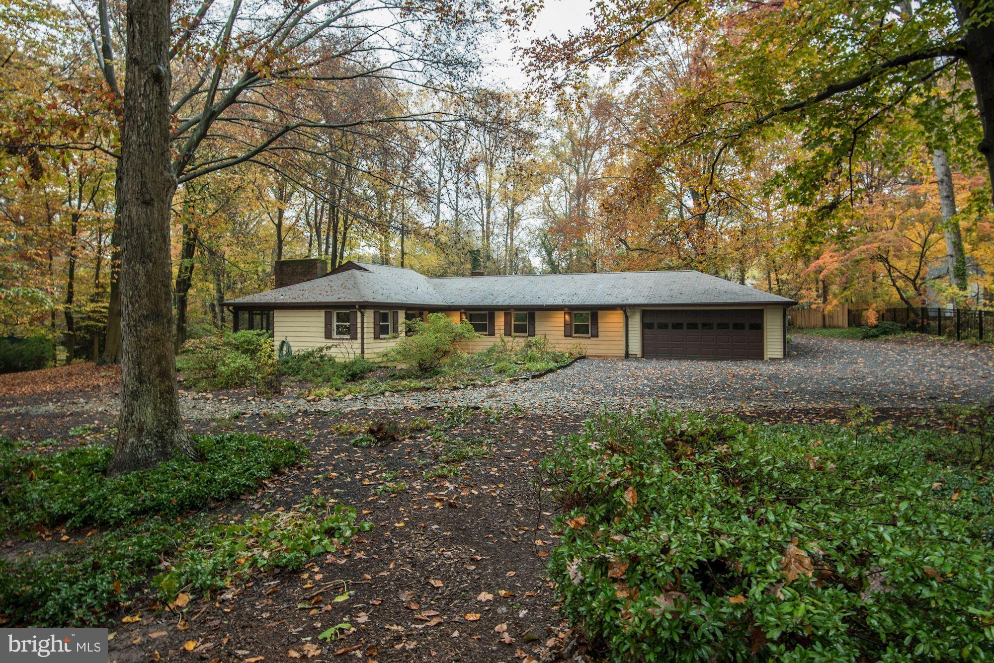 One-level Mid-century modern home on 1 acre lot in wooded wonderland. 4BR 2.5BA w/2 car attached garage PLUS amazing 12 car detached garage. Perfect opportunity for a car lover to tinker away. Formal LR w FP, formal DR, sunny kitchen+Bfast room. Master suite + sitting room w/ 3 more bedrooms + hall bath on separate wing. 2 screened porches. Easy access to commuter routes. OPEN SUN 2-4!