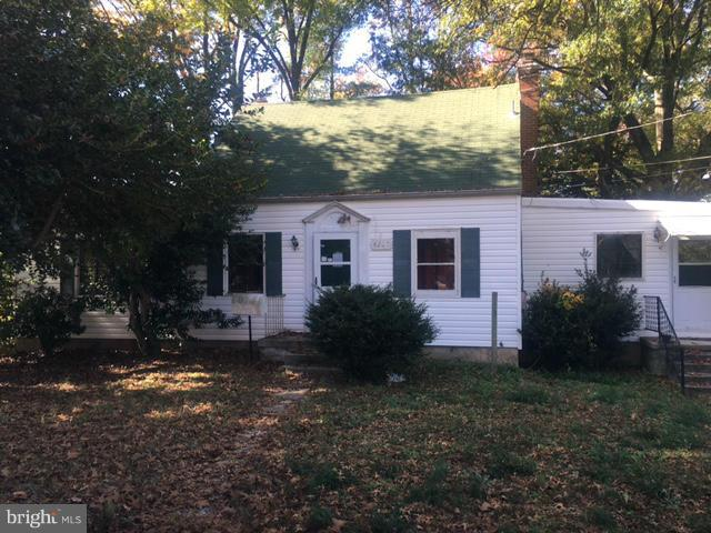 Rehab Ready Cape Cod in Morningside deserves a  face lift. Hardwood floors under carpet, main level half bathroom, sep dining room, brick fireplace. Sold as-is with any faults in place.