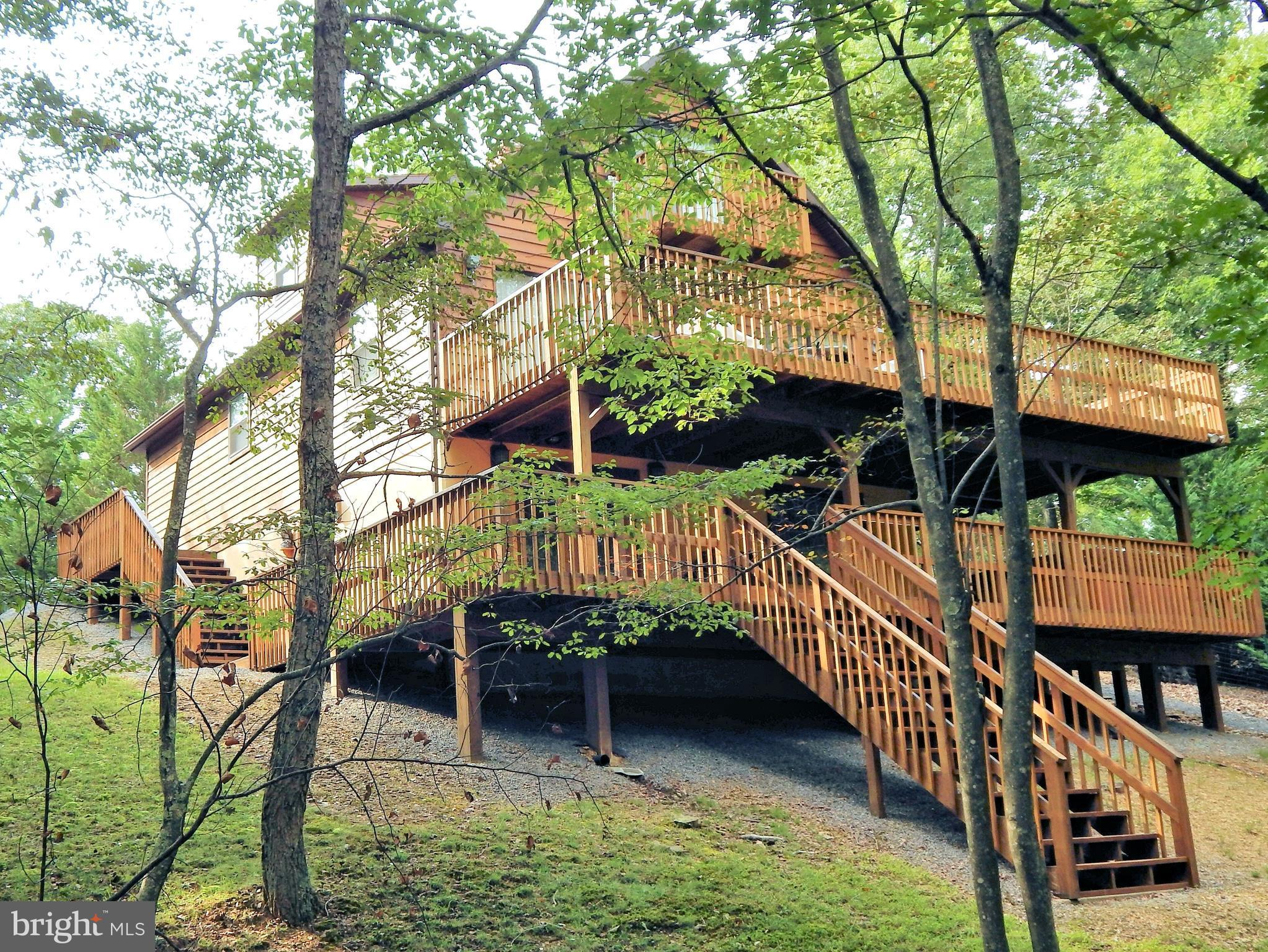Stunning chalet of the highest quality, If you are searching for the best your search stops here! Beautiful mountain views that change with the seasons. Three floors of living, game room, hot tub, central air / heat & wood stove. Located in River Ridge, premier waterfront community allows you to take advantage of miles of river, both the Cacapon and Potomac, hiking & biking trails, Sidling Mt WMA!