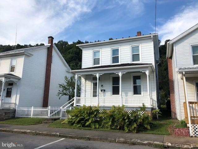 This is NOT a foreclosure. If you are looking for a really well maintained home in town with nice lot with white picket fence to start your family look no further!!! Plenty of storage with the attic, basement and two detached sheds in the rear with room to make parking or build a garage.  Freshly painted in most rooms and 1 year old metal roof on rear addition. The windows are replacement windows & there is interior and exterior access to basement.  Really nice turnkey property just waiting for you to come check out!