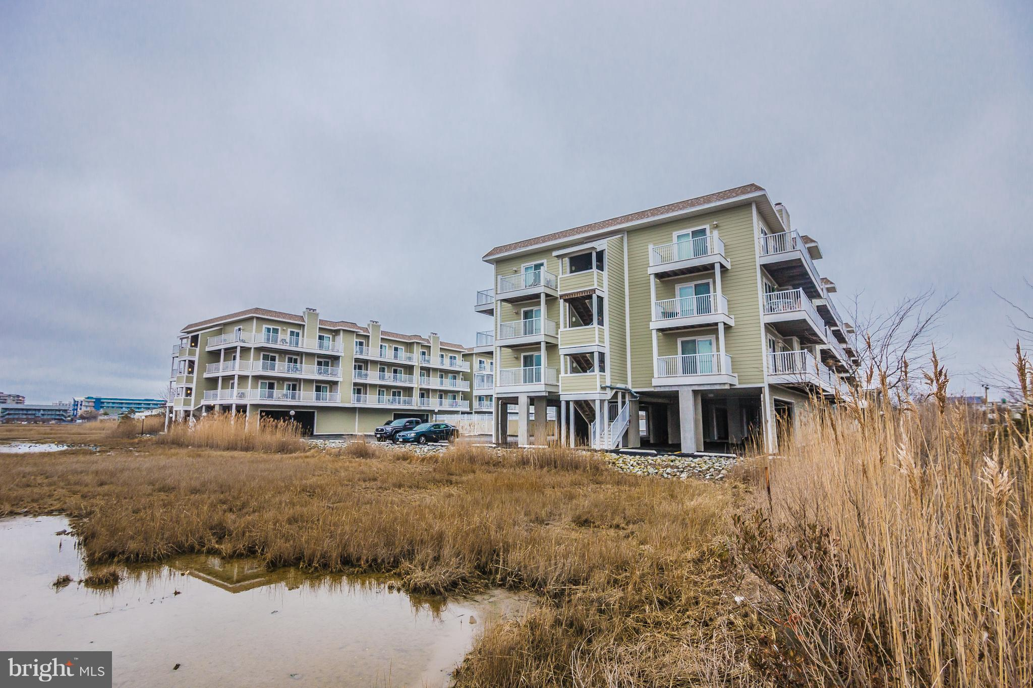 Well maintained 2 bed 2 bath condo with outdoor pool.  This prime unit is the top floor west end with amazing bay & sunset views.  2 Balconies one off master bedroom and one of family room.  Light and bright south and west exposure.  Just two short blocks to the beach.  Building has replaced siding, roof, elevator decks etc.