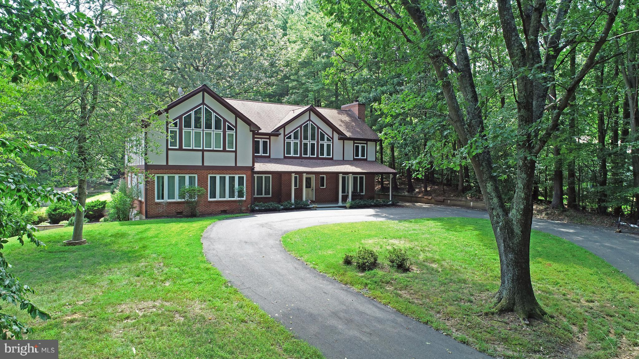 Spectacular Home in Country-Like Setting! Major remodel between '08 & '12.  Virtually entire home has been replaced, with meticulous detail.  Custom cherry cabs in kitchen, heated marble floor foyer, incredible master bedroom with gas FP. In-law suite in basement,1000 gal propane tank fuels emergency generator, fireplace and cook top. Large open space, plenty of parking and storage. Come and See!
