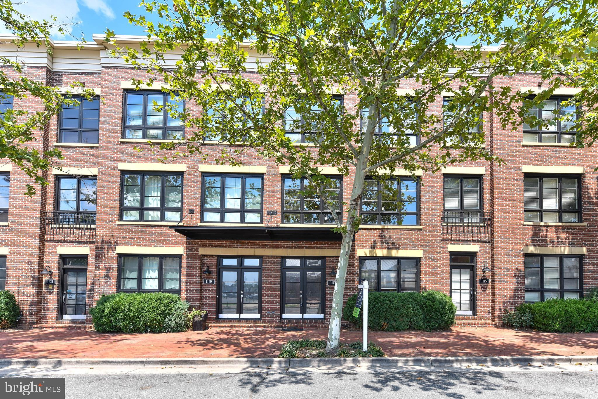 Urban Loft w/2,720 sf of fabulous living space and ROOF TOP DECK w/expansive Southern views. THREE BEDROOM SUITES PLUS DEN and TWO CAR GARAGE. Open floor plan Kitchen/Dining/Living, great for entertaining! Hardwood floors, 9' ceilings, fireplace, zoned HVAC. Steps to Braddock Metro.