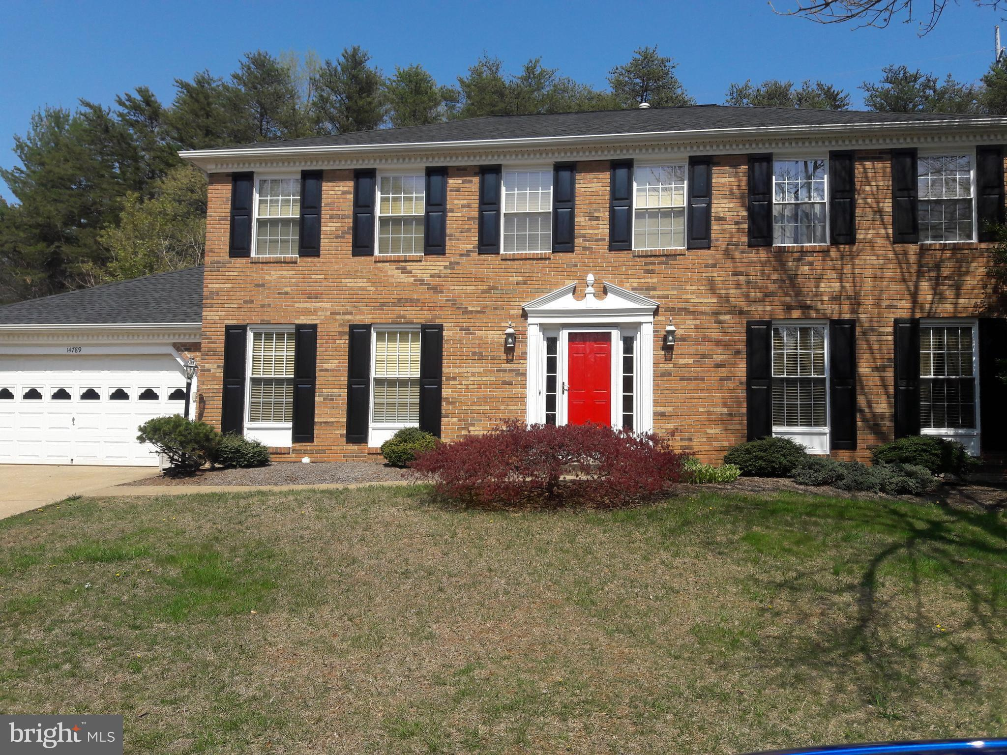 Brick front colonial on quiet street. Privacy fence, flat yard & screened porch backing to trees. Hardwood main level w/open-concept kitchen/eat-in/family rm w/gas fireplace. Granite/stainless & other updates. Five beds up, 4 piece master bath. Basement has full bath, bonus room & storage. 2-car garage w/many shelves & walk-up attic. Roof & dryer 1yo, furnace 2yo, washer 4yo. Well cared-for home!!
