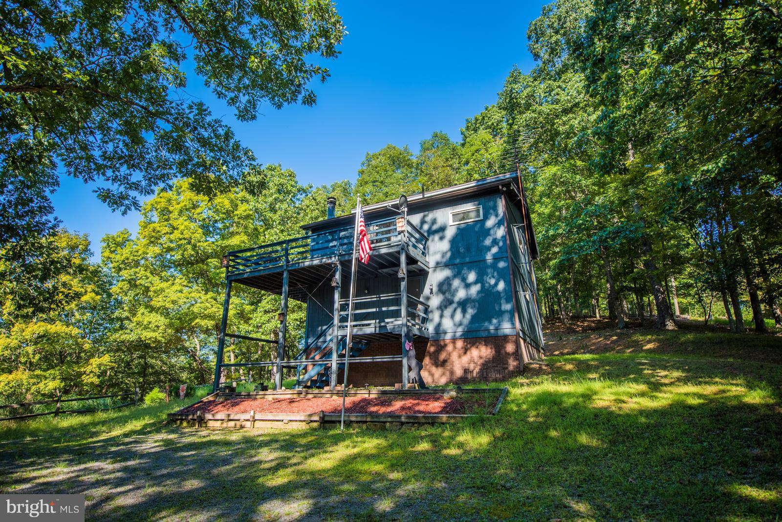 Enjoy the sounds of sights and sounds of nature from the deck of this lovely contemporary home in River Ridge, just 20 minutes to the historic town of Berkeley Springs, WV.  Waterfront on the Cacapon River, community river access and picnic area.  Three bedroom, 2 bath home with large great room, stone corner wood burning fireplace, and plenty of windows for natural light and to enjoy the views.