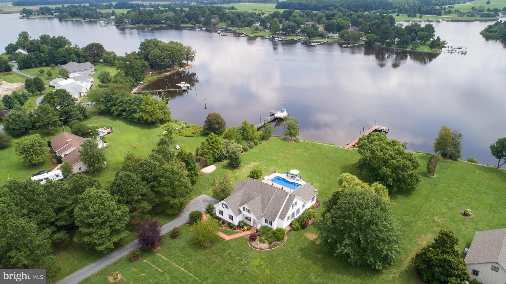 Price Reduction on this Impeccably maintained waterfront home featuring an open concept floor plan w/ 4BR's, 2.5BA's , eat-in kitchen, living room w/cathedral ceiling and gas FP, sep dining room, 2-car garage w/ bonus room above garage, screened in porch overlooks fiberglass in-ground saltwater heated Jacuzzi pool, lots of windows to let the light in and enjoy the beautiful view of the water, pier with water and electric.