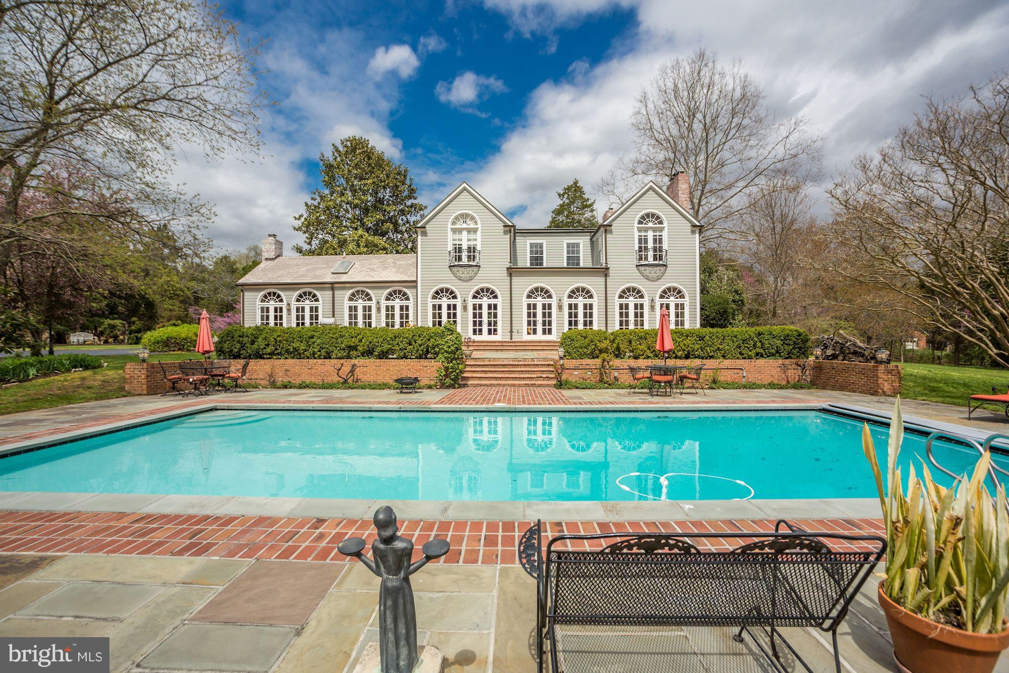 Historic Main house over 5000 ft has been renovated to perfection 3 baths in '16; Total Kitchen in '11; Entire back of home has 10 set of palladium french doors; wide-planked wooden floors; 4 Frpl & Dental trim;+ Pool redone '10, Tennis court '13 & German Bank Barn w/ 2 car gar. workshop/storage, LL room for tractor, cars & boat, 3rd lvl is for office. close to Park* A treat to the Eye & the Soul