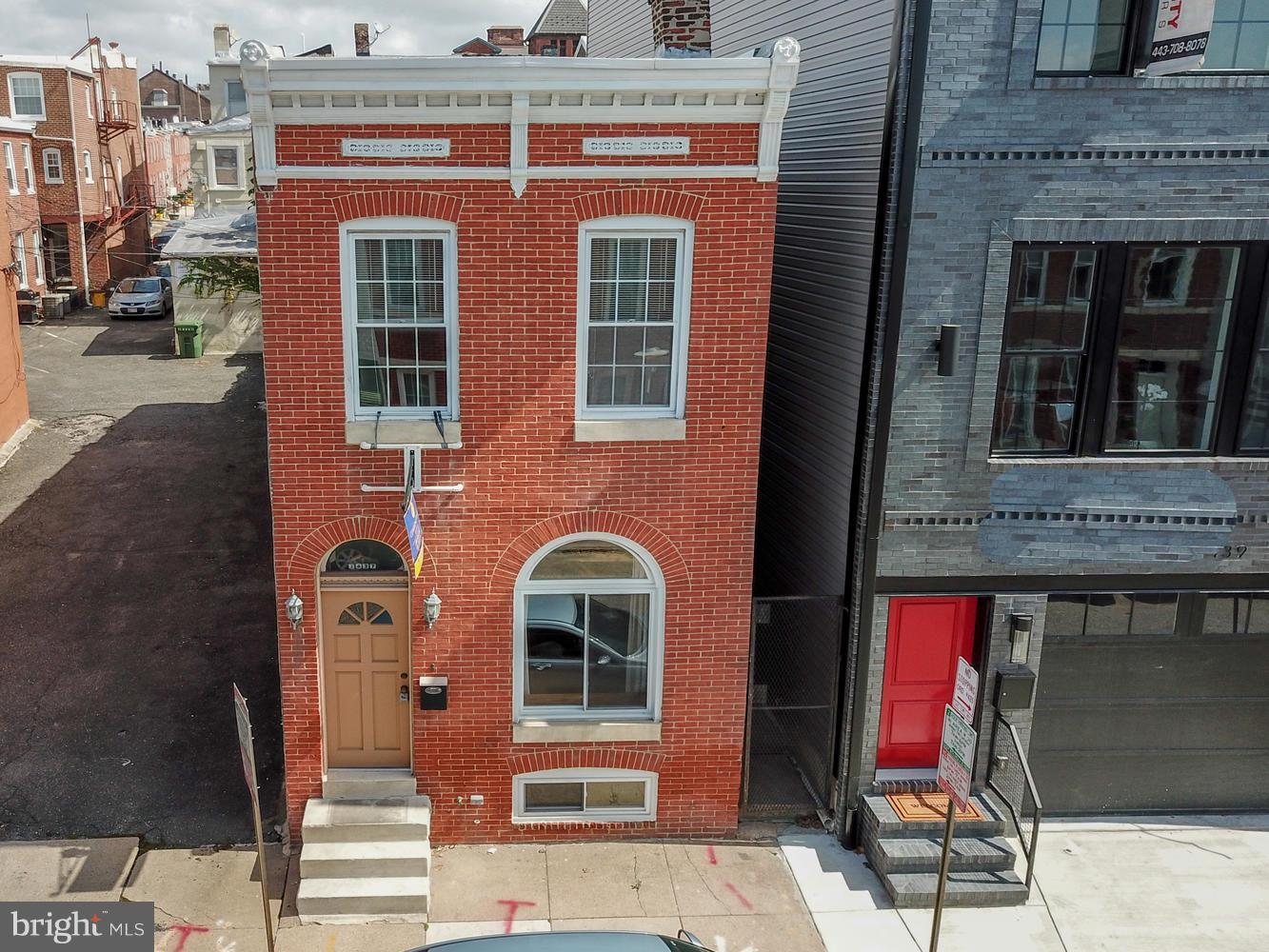 Unique opportunity for a completely detached home in Federal Hill! Tons of Historic Baltimore Charm including original hardwoods, arched doorways and exposed brick with modern amenities and new ss appliances and granite counters. Upper level has a sizable master with en suite full bathroom and addtl bed & hall bath. Private rear courtyard. Great location convenient to parks, shops and restaurants!
