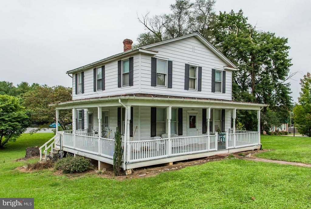 This older farmhouse is in need of total rehab or tear down. Currently tenant occupied. The value is in the Location.  Zoned C4 in the Town of Purcellville allowing for a lengthy list of business uses. Excellent road frontage and excellent yard.  Hardwood floors and nice wrap porch and close to the W & OD Trail.